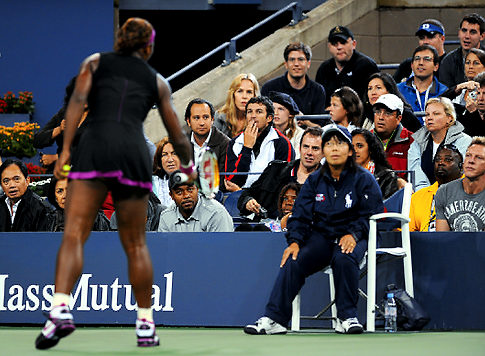 The guy in the stand can't believe what Serena just said to the lineswoman (who had no idea what she said)